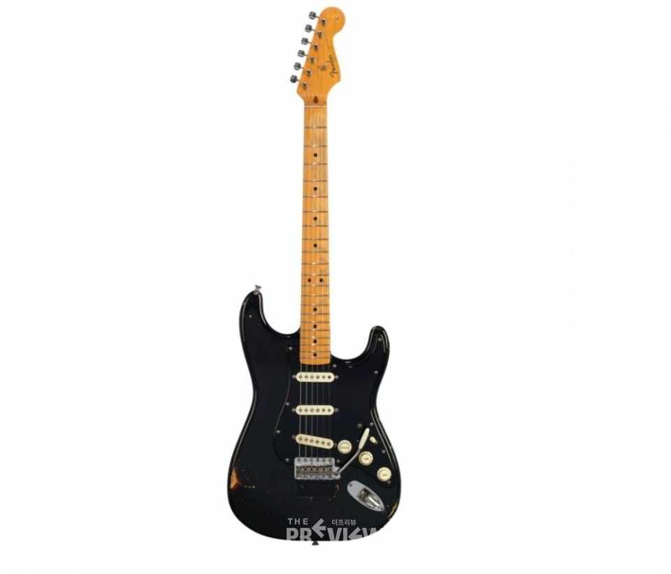 Fender Electric Instrument Company, Fullerton, 1969 and 1983. A solid-body electric guitar, Stratocaster, known as 'The Black Strat'. Length of back 15⅞ in (39.7 cm) (Photo Source: Christie official site)